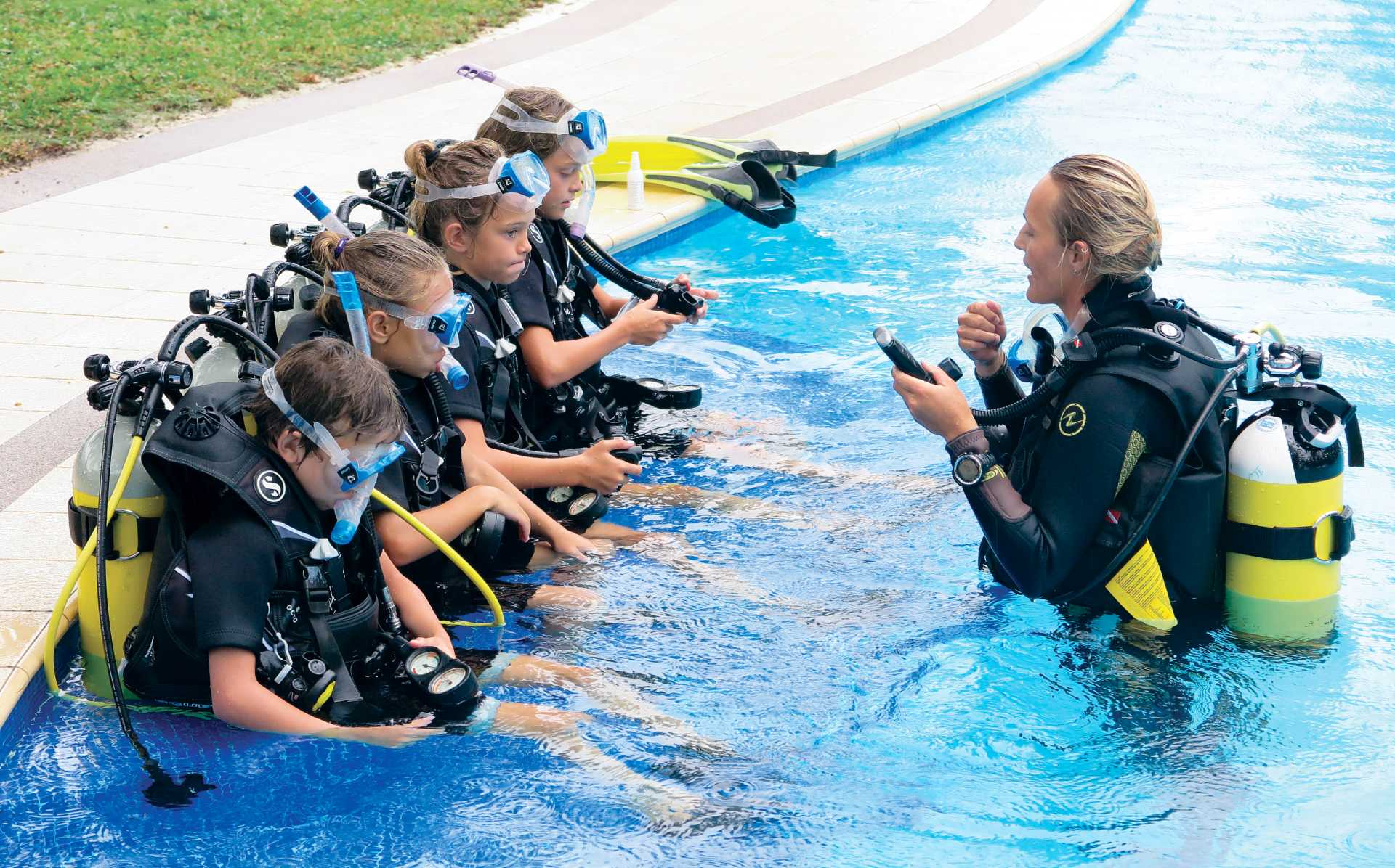 kids children scuba diving seychelles
